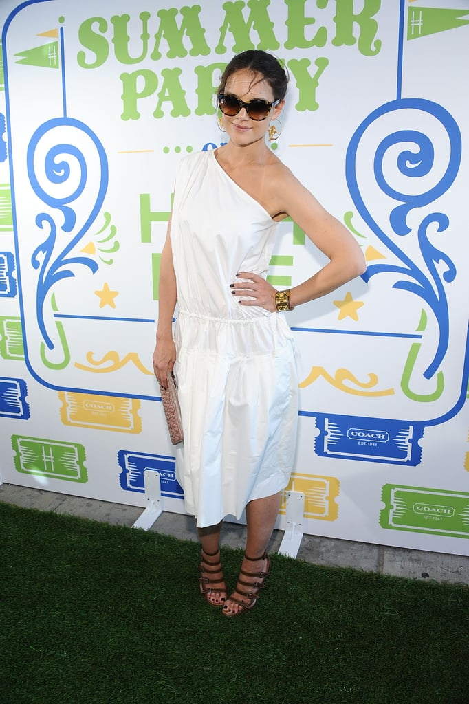 Katie Holmes wore a crisp white dress.