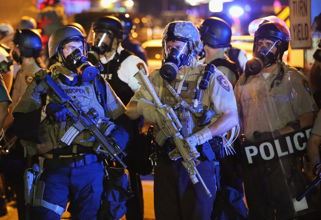 Police in combat gear and gas masks stood in the streets.