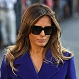 Melania departed the White House for her Asia tour in a purple Emilio Pucci coat and matching Christian Louboutin heels. She kept her accessories minimal, slipping on these dark shades.