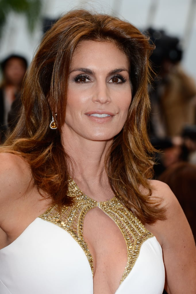 Cindy Crawford attended the opening ceremonies of the Cannes Film Festival looking as glamorous as ever with a soft smoky eye and voluminous blowout.