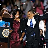 Michelle and Barack flashed big smiles as they held hands on election night.