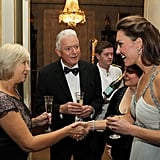 Kate's first solo engagement was a charity ball for In Kind Direct, which she attended on father-in-law Prince Charles's behalf.