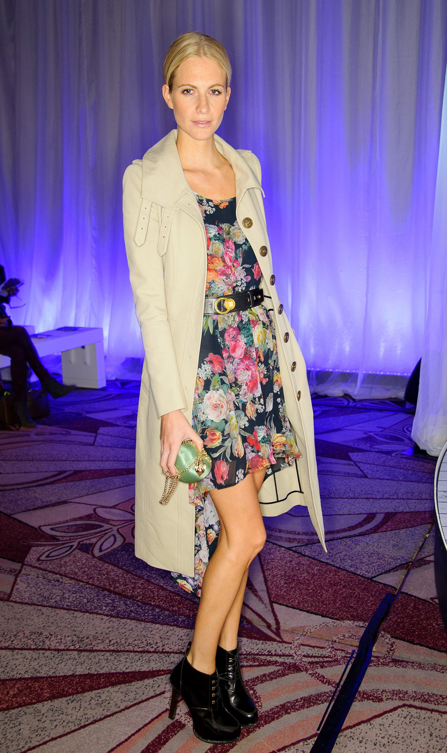 Poppy Delevingne paired a floral-print dress with a military-style trench and ankle boots at Anya Hindmarch in London.
