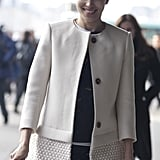 Caroline Issa made the chicest kind of arrival in a creamy, textured coat.