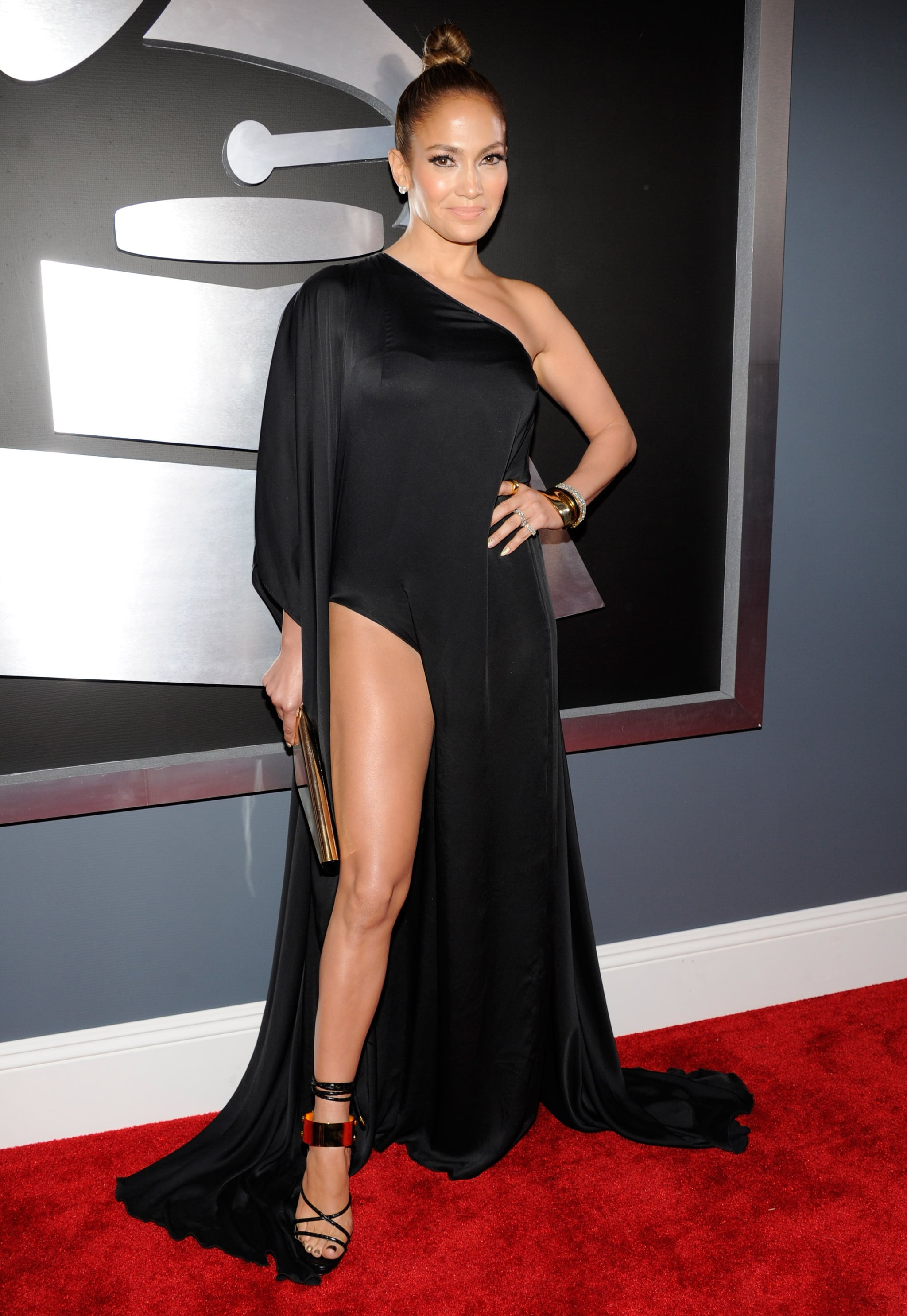 Jennifer Lopez showed off her legs in an Anthony Vaccarello gown with a high slit at the Grammys.