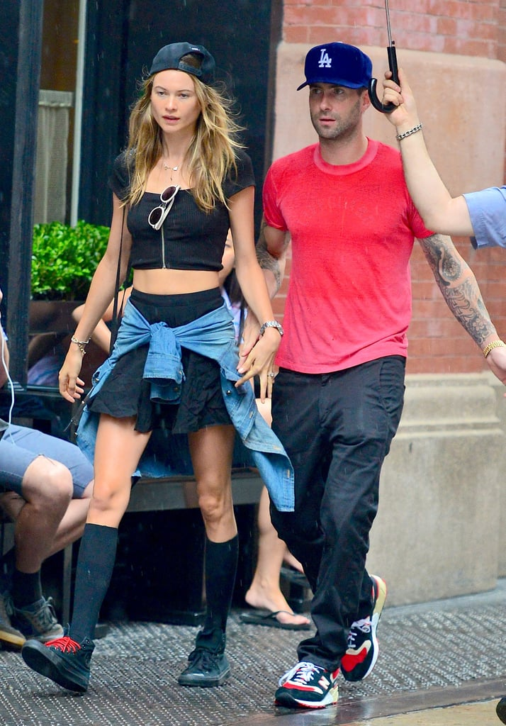 Behati Prinsloo goes for grunge while braving the rain in NYC.