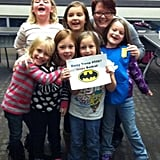 Daisy Troop #5987 cheers on the superhero. Source: Facebook user Batkid Photo Project
