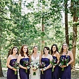 This bride chose matching knee-length navy dresses for her bridesmaids.