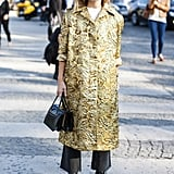 . . . Miroslava Duma did the same, buttoning hers up over trousers and a tee in Paris.