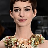 Anne Hathaway showed off her short hair at the Dark Knight Rises premiere.