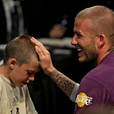 This adorable moment between David and Brooklyn happened at an LA Lakers game back in June 2008.