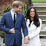 Meghan proudly showed off her gorgeous engagement ring, complete with three giant stones, while smiling from ear to ear alongside her husband-to-be. I mean, wouldn't you be as giddy as a schoolgirl if your man personally designed a ring like that just for you?