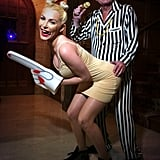 Hugh Hefner sported a striped suit as Robin Thicke, re-creating the MTV VMAs performance with Crystal Harris as Miley Cyrus. Source: Twitter user hughhefner