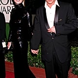 Then: When Kate dated Johnny Depp, she made lots of red carpet appearances by his side. While she wore plenty of Calvin Klein slip dresses, this high-fashion sequined gown looked just as effortless with a simple chignon hairstyle.