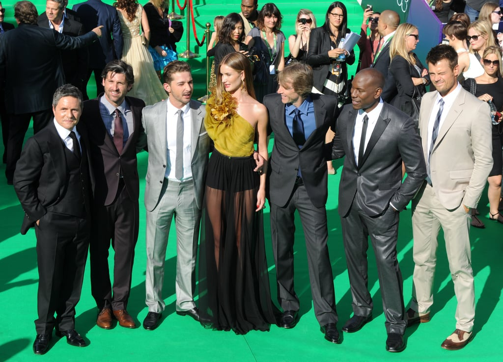 Shia LaBeouf and his costars Rosie Huntington-Whiteley, Tyrese Gibson, Patrick Dempsey, and Josh Duhamel joined director Michael Bay in Moscow today for an early morning photo call followed by the Transformers: Dark of the Moon world premiere. The men suited up for their international debut, while Rosie stepped out in sheer skirt and gold top for the green carpet after changing out of the vivid Michael Kors gown she wore earlier in the day. Patrick and Rosie are newcomers to the action franchise, with Rosie replacing Megan Fox as Shia's onscreen love interest. In real life Shia's been kicking it with Karolyn Pho, after splitting with Carey Mulligan late last year. Josh may be overseas for work obligations but he's keeping the people of his hometown of Minot, ND, in his thoughts, tweeting them messages and well wishes after the town was recently hit with devastating floods.