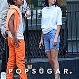 While hanging with friends in New York, Kendall tried denim bermuda shorts on for size, finishing her outfit with a white Telfar polo and her Adidas Low Forum sneakers.