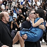 Alec Baldwin and Hilaria Thomas kissed at his Seduced and Abandoned photocall in Cannes.
