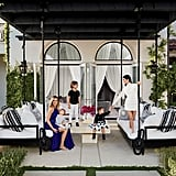"Khloé's outdoor lounge area — pictured here — is representative of her romantic, Middle Eastern-inspired decor style. Of her and Kourtney's contrasting styles, Khloé said, ""Our tastes are very specific and completely different. When we go furniture shopping, I stand there tapping my foot while Kourtney shows me modern pieces. Then we head somewhere full of exotic, beautiful things and all she can say is, 'I like nothing here.'"""