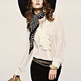 If dresses aren't your thing, you can still look fancy with a delicate ruffle blouse, silk scarf, and extra jewels.