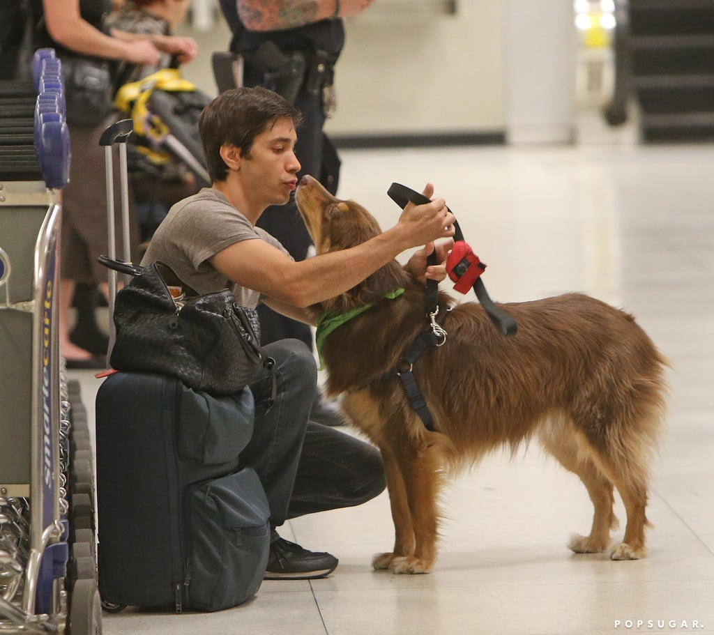 Justin Long gave Amanda Seyfried's dog, Finn, a kiss at the airport in NYC.