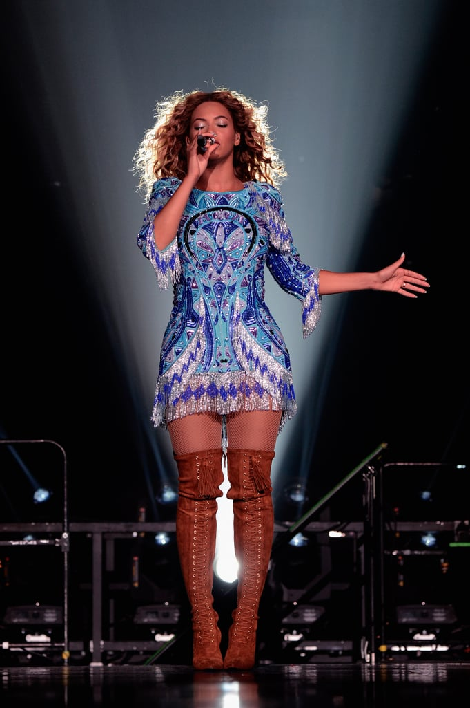 Beyoncé channeled a boho-goddess vibe in a fringed mini-dress and thigh-high lace-up boots.