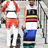 Miroslava Duma (right) and another styler have the photogs mesmerized in bold prints.