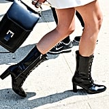 Patent midrise lace-up boots don't feel the least bit costumey on the streets at Fashion Week.
