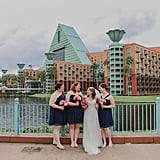 The bridesmaids at this Disney wedding sported knee-length navy dresses.