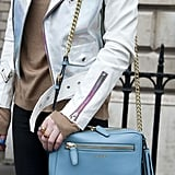 Powder blue Coach was a cool pop of color against a holographic jacket.