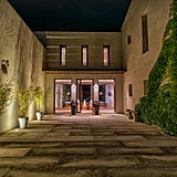 """The approach to the villa features a private vine-flanked driveway leading up to the dramatic entrance. Perfect for mastering that """"Flack attack"""" strut!"""