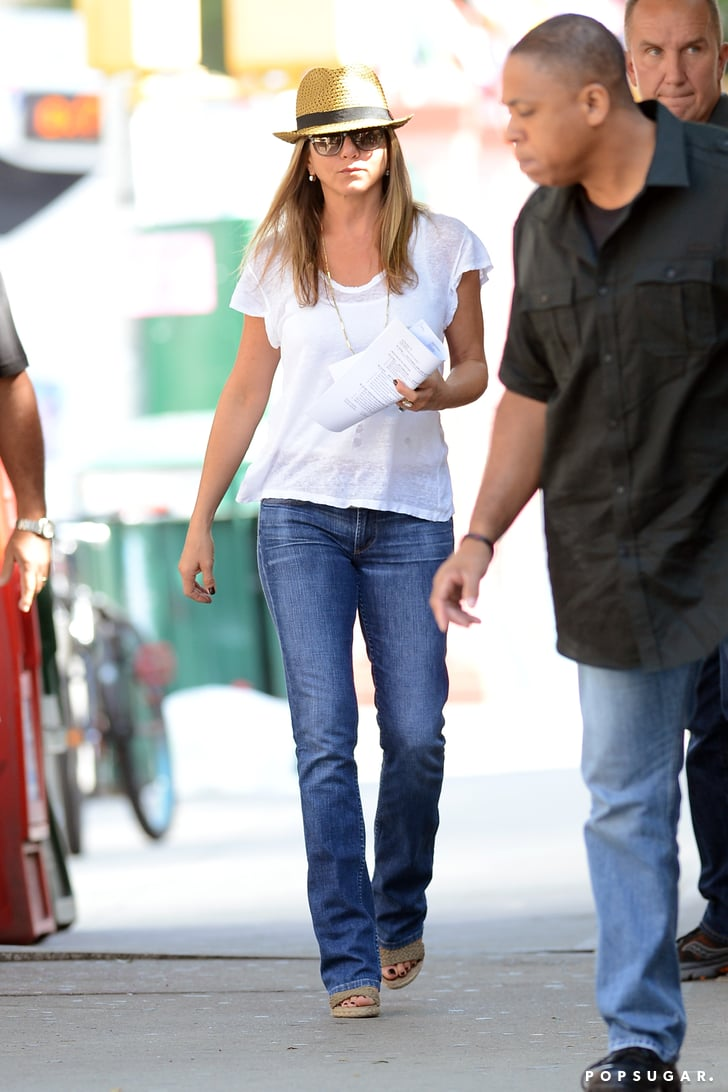 Jennifer Aniston Wore A White T Shirt And Fedora On Her