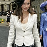 For a wedding in 2005, Kate added interest to her white and black look with a ribbon-adorned head piece.