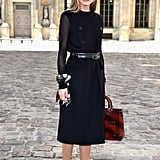 At the Dior show during Paris Fashion Week, Olivia chose unexpected accessories, like a scarf bracelet, a subtly striped oxblood bag, and tassel-embellished shoes.