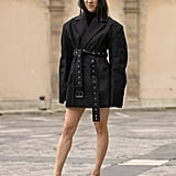 For an outfit you can wear on date night, wear an oversize blazer as a dress and pair it with mules like Eva Chen.