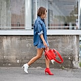 Try a chambray top or jean jacket with a denim mini skirt. Bright, mismatched accessories give the look a playful spin.