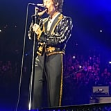Harry Styles Wearing a Black Gucci Suit in 2018