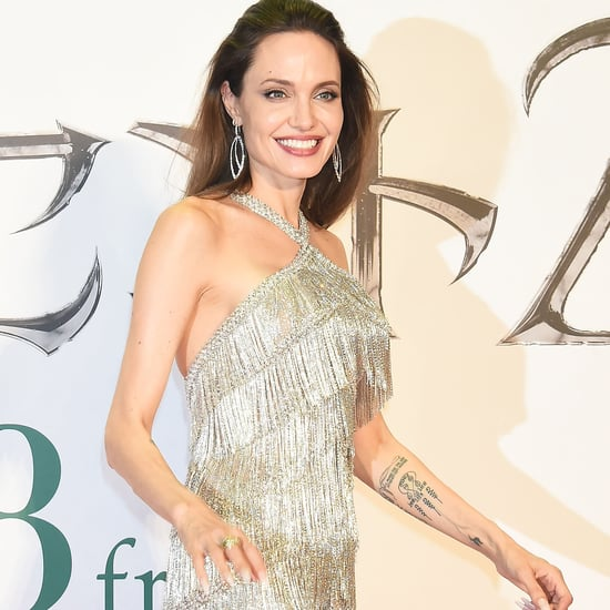 See Angelina Jolie's Silver Gown at Maleficent Premiere