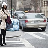 Sara Sampaio wearing a Chanel bag and Stuart Weitzman boots.