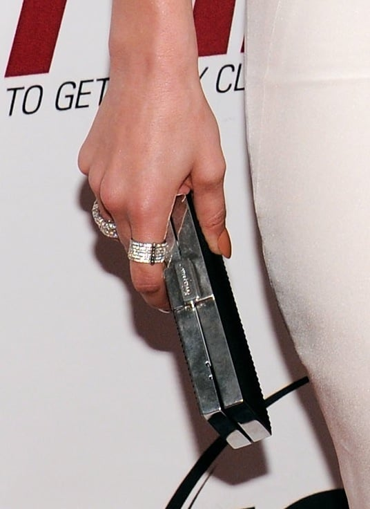 The actress polished off her look with statement rings and a black box clutch.