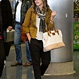 While arriving at LAX airport, Sophia layered up with a safari jacket,  striped fringe Co-Op scarf, loose-fitting black pants by Wheat Civilian, and a canvas Apolis bag ($218). A gold watch and round sunglasses completed her travel-cool look.
