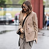 Light brown pants feel cooler with a borrowed-from-the-boys blazer and sharp sunnies.