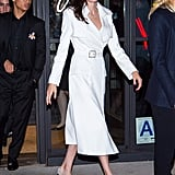 Play Up Your Classic White Trench Coat With Dazzling Jewels and Glitter Shoes