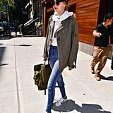 She Paired It With a Military Coat, Sweatshirt, and Skinny Jeans