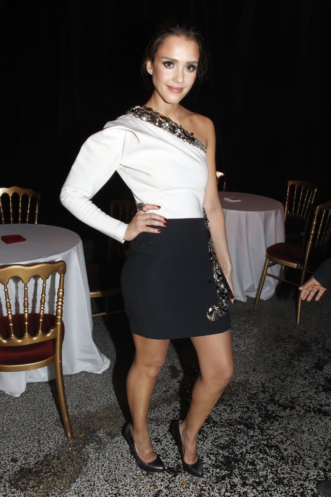 Jessica Alba wore an embellished one-shouldered cocktail dress to the Lanvin runway show.