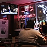 The hearing appears on TV at the Billy Goat Tavern in Chicago.