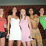 The Spice Girls huddled together at an April 1997 press event in Bali.