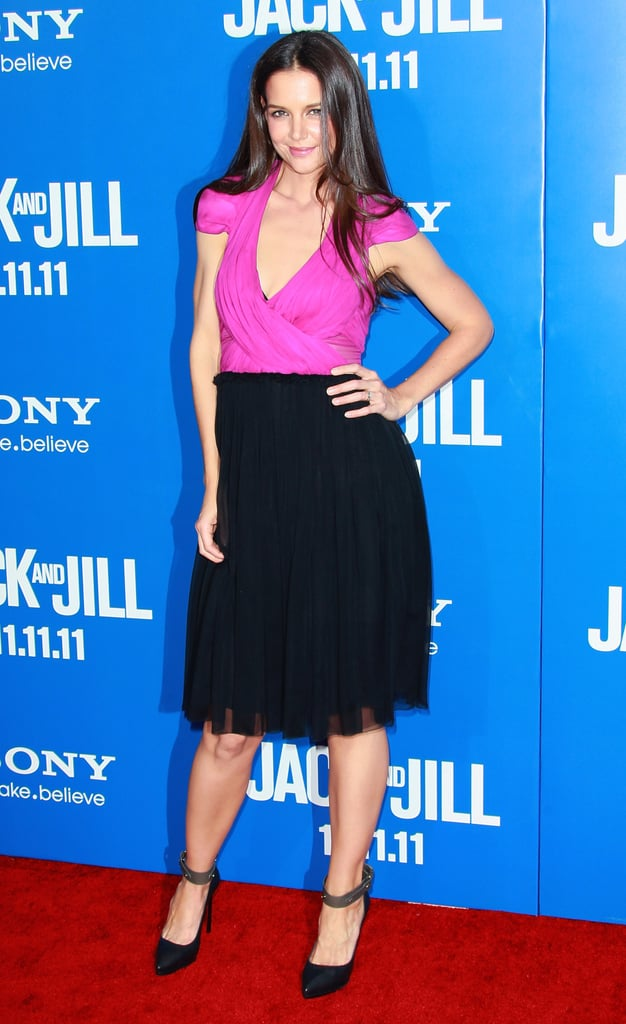 """Adam Sandler and Katie Holmes teamed up in LA last night for the premiere of Jack and Jill. His wife, Jackie Titone, posed for photos on the red carpet, though Katie's spouse, Tom Cruise, wasn't able to attend due to his work commitments in Pennsylvania for One Shot. Katie was decked out in a two-toned dress from her Holmes & Yang line, pairing the frock with shoes from Lanvin. The screening was the final event in a weekend of togetherness for Katie and Adam. They were busy with junket interviews over the last few days — stay tuned for those on PopSugar soon! The comedy, which is out on Nov. 11, marks Katie's return to the big screen after August's Don't Be Afraid of the Dark, and she also has The Son of No One out Nov. 4. Katie's done time on TV recently as well, having starred as """"the slutty pumpkin"""" on How I Met Your Mother."""