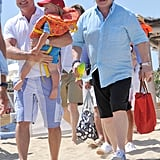 Elton John, David Furnish, and Zachary Furnish-John hit the beach.