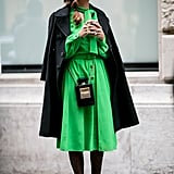 This emerald shade was a vibrant contrast to all-black extras.