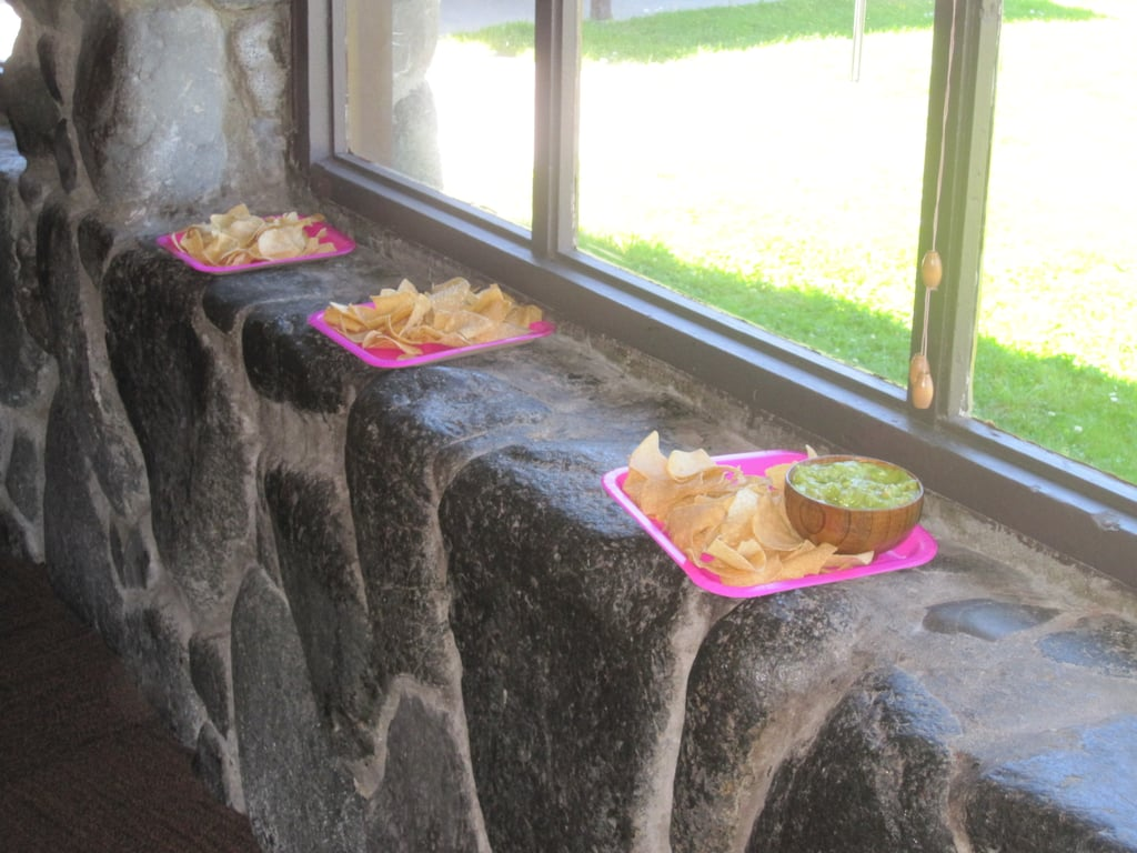 Plates of chips and bowls of guacamole and salsa dotted the outside rim of the room, making it easy for everyone to grab a chip and eat it.